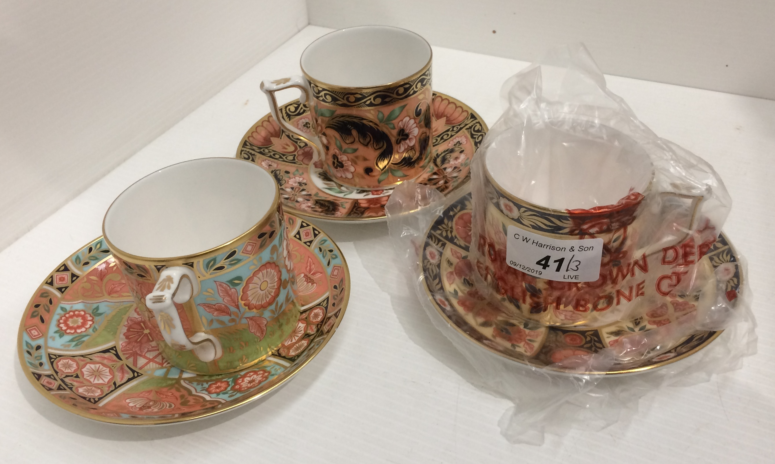 Lot 41 - Three Royal Crown Derby bone china cup and saucer sets - patterns - Regency Flowers,
