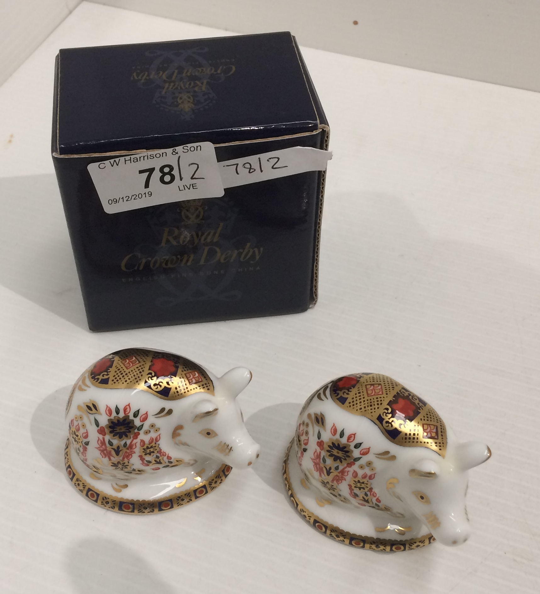 Lot 78 - Two Royal Crown Derby bone china paperweights of Piglets each 7cm long (only one with box)