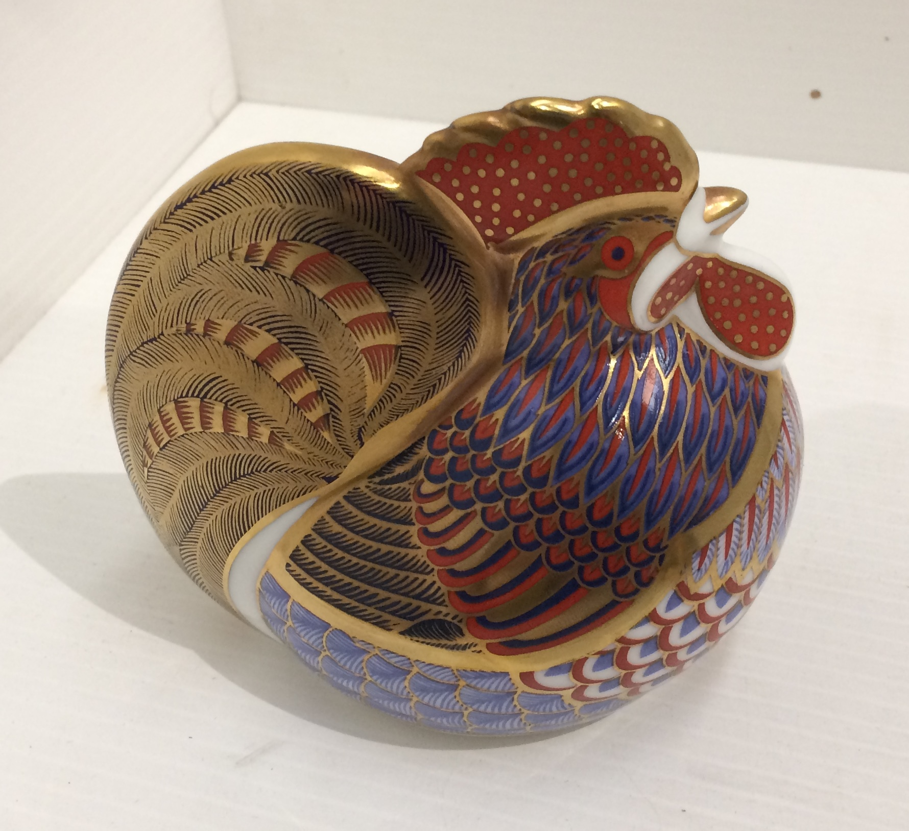 Lot 34 - A Royal Crown Derby bone china Hen paperweight