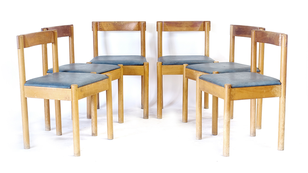 Lot 46 - A set of six 1960's pine and blue vinyl dining chairs with unusual backs and joints