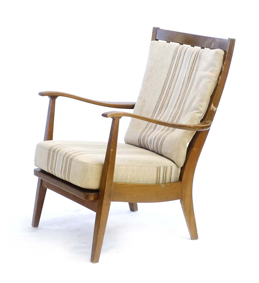 Lot 15 - A 1960's beech armchair with loose striped cushions