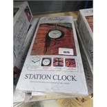 2 boxed station clocks