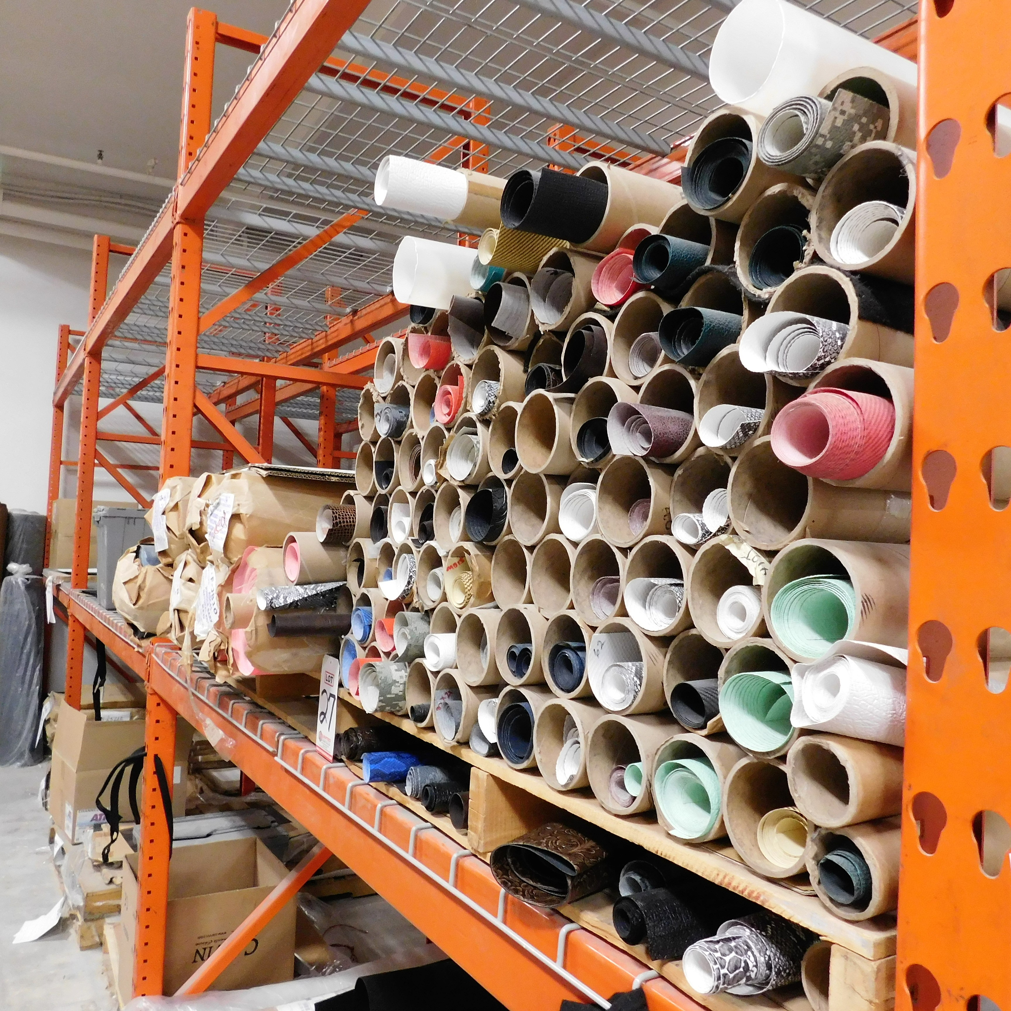 """Lot 27 - LOT - (2) PALLETS OF VINYL ROLLS IN NUMEROUS COLORS AND PRINTS, TYPICAL ROLL WIDTH IS 54"""""""
