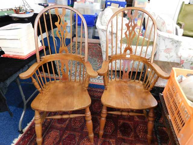 Lot 10 - A pair of hoop back armchairs