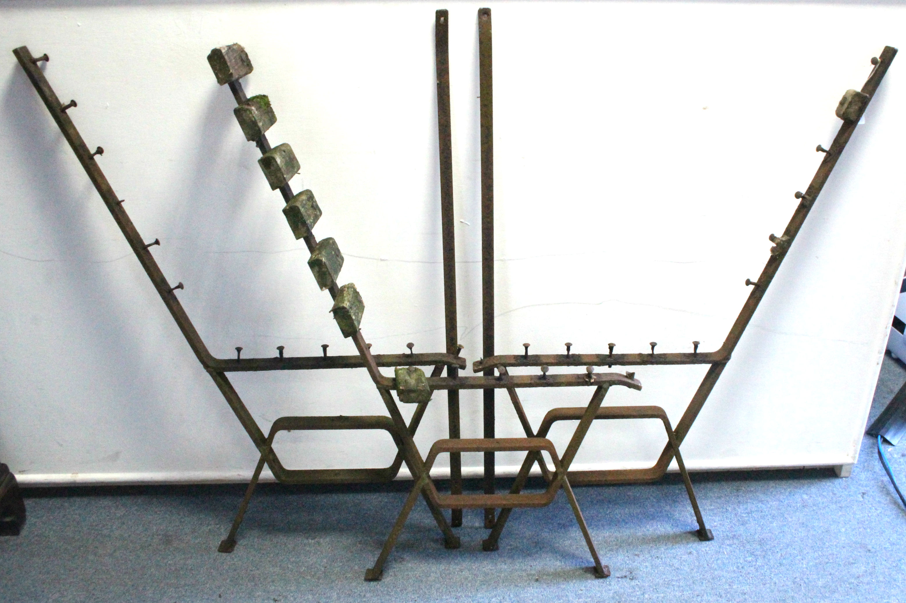 "Lot 3 - A set of three cast-iron garden bench supports, 38"" high."