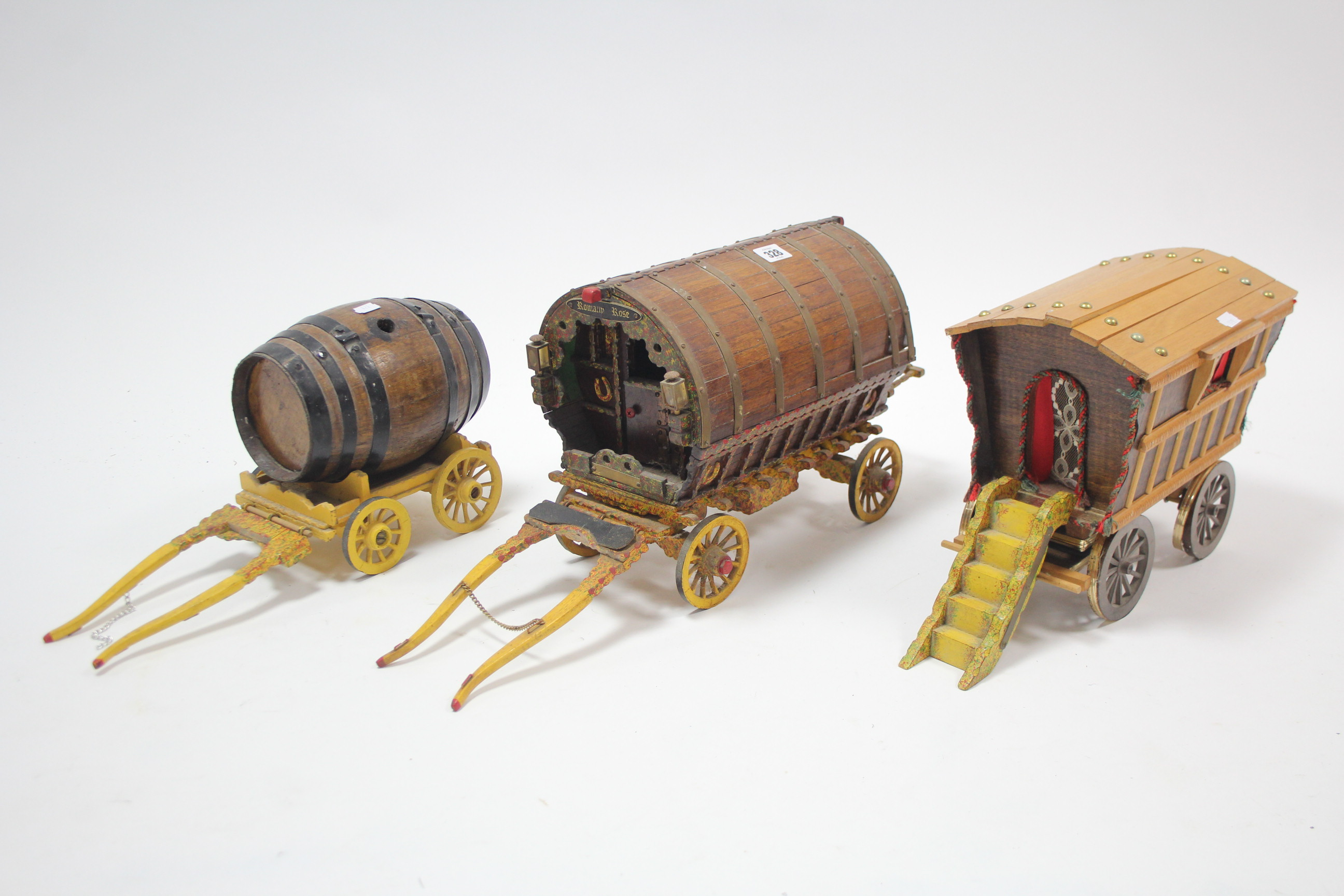 Lot 328 - Three large wooden model carts (various sizes).