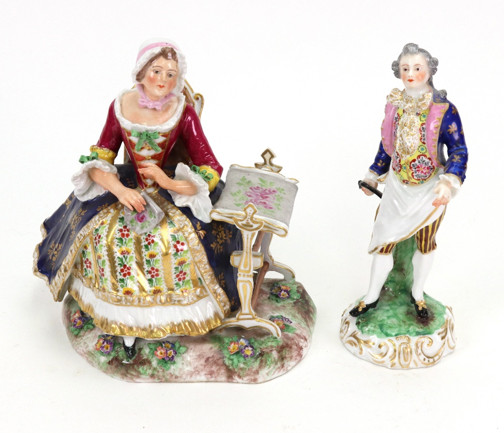 Lot 37 - A Derby style porcelain figure of a lady, seated in a chair beside a tapestry and frame, 18cm high,