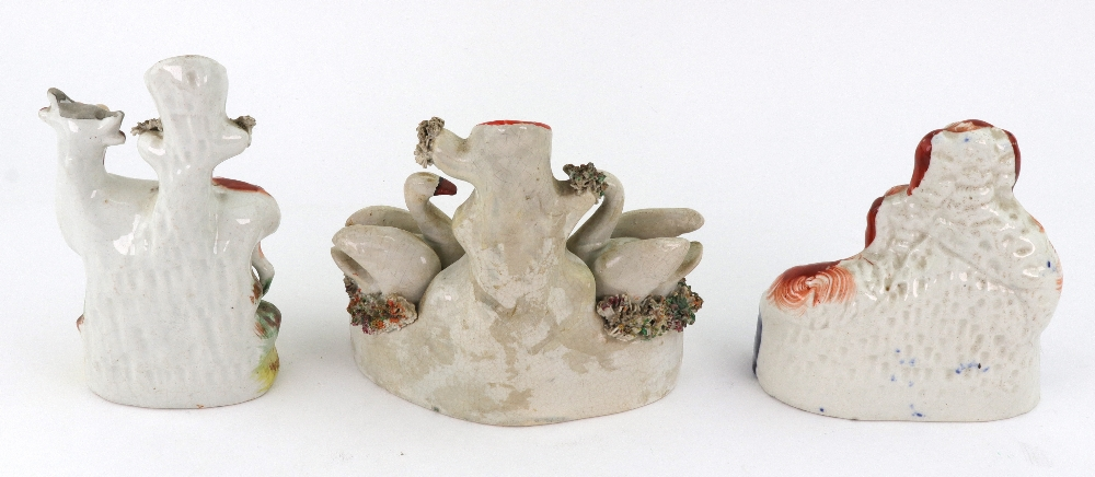 Lot 9 - A Staffordshire pottery model of a church, frit decorated, 15cm wide,