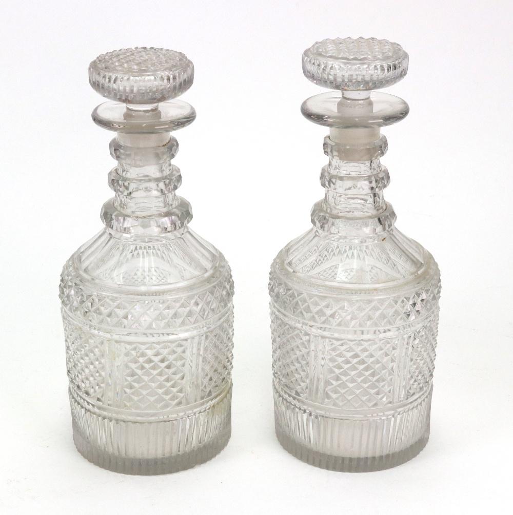 Lot 43 - A pair of Regency diamond split and facet cut glass decanters,