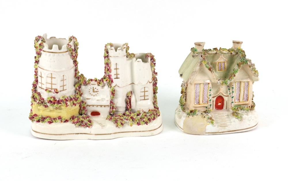 Lot 45 - A collection of Victorian Staffordshire, a pair of cows and milkmaid spill vases, 15cm high,