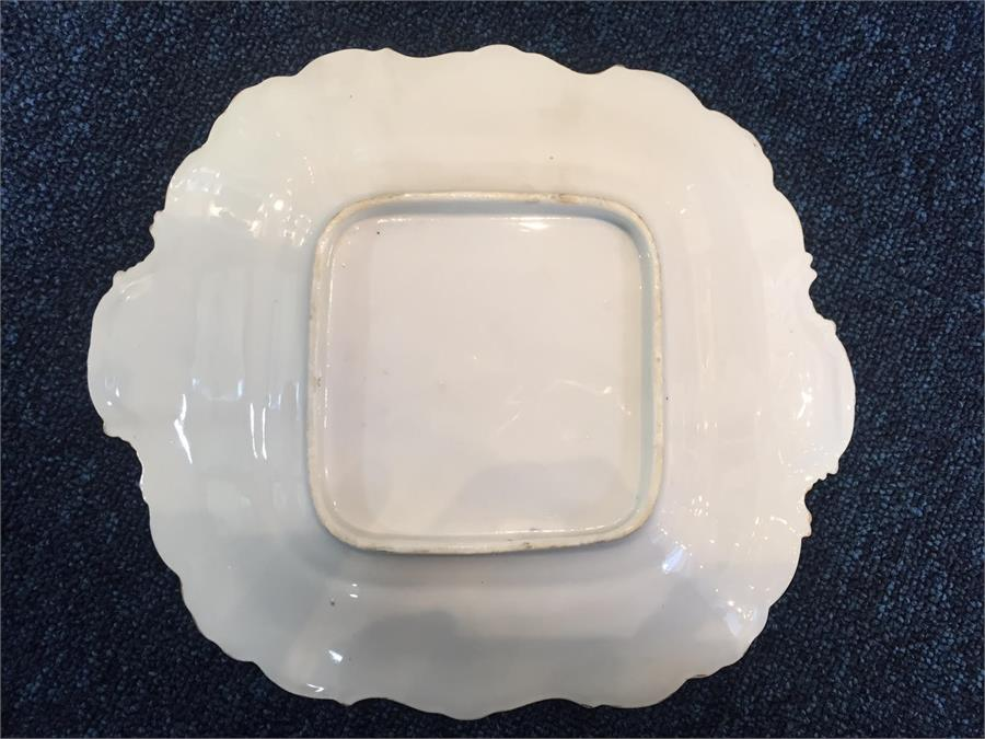 Lot 425 - A 19th century hand painted ceramic part dinner service consisting of two pedestal bowls, two dinner