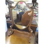 An early 19th century mahogany dressing table swing mirror