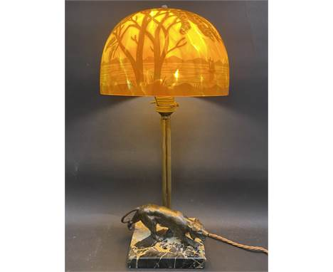 An Art Deco 1930s table lamp, the glass shade in the manner of Galle, the marble base surmounted by a bronze wolf, re-wired a