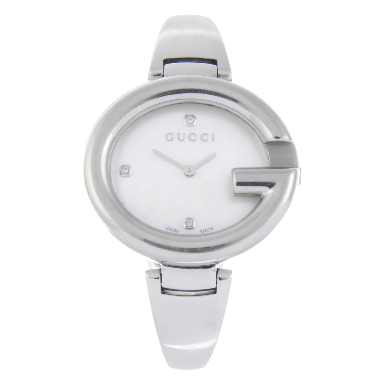 Lot 49 - GUCCI - a lady's Guccissima bracelet watch.