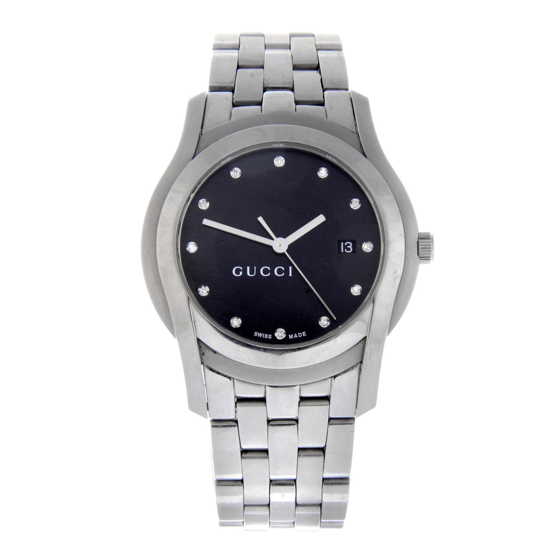 Lot 50 - GUCCI - a 5500XL bracelet watch.