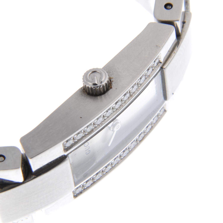 Lot 52 - GUCCI - a lady's 4600L bracelet watch.