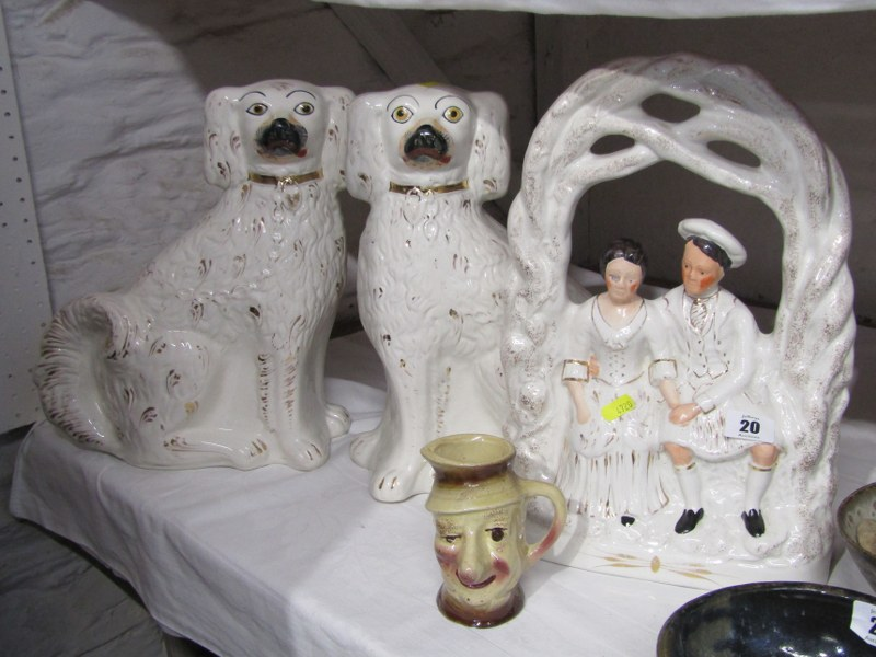 STAFFORDSHIRE POTTERY, gilded pottery bower courting group; also pair gilt seated spaniels & Ally