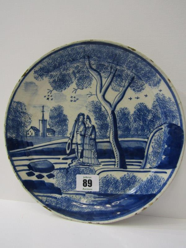 """EARLY DELFT, early 18th Century possibly English Delft """"Pancake"""" 9"""" plate depicting couple within"""