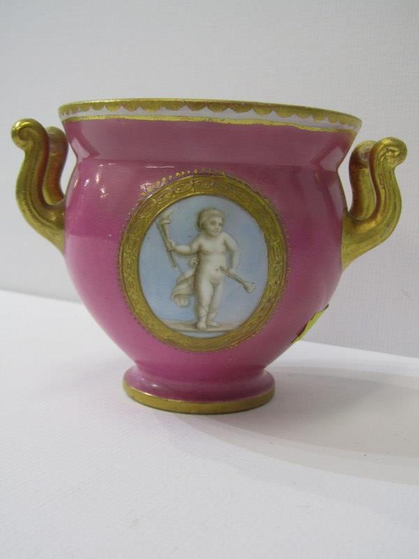 COALPORT, a gilt twin handled pink ground table pot, gilt ampersand mark (restored)