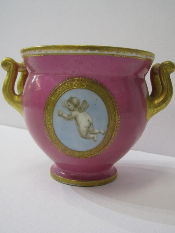 COALPORT, a gilt twin handled pink ground table pot, gilt ampersand mark (restored) - Image 2 of 3