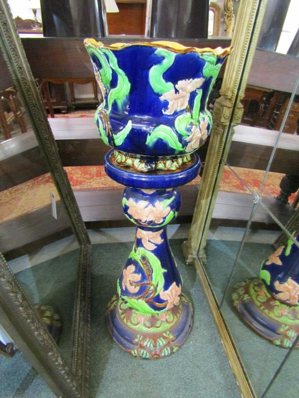 MAJOLICA, blue ground foliate design jardiniere and stand, base moulded Cobbs of Oxford, height 37""