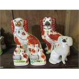 STAFFORDSHIRE POTTERY, 2 Victorian seated Ochre Spaniels, pair of miniature spaniel groups and 1