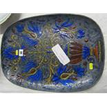 QUIMPER, a signed art pottery enamelled plaque by Marjatta Taburet decorated with stylised vase of