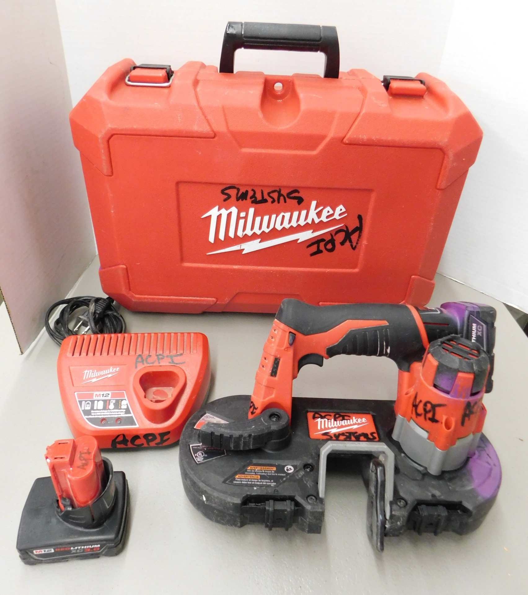Lot 262 - Milwaukee Model 2429-20 12V Cordless Portable Bandsaw with Battery and Charger