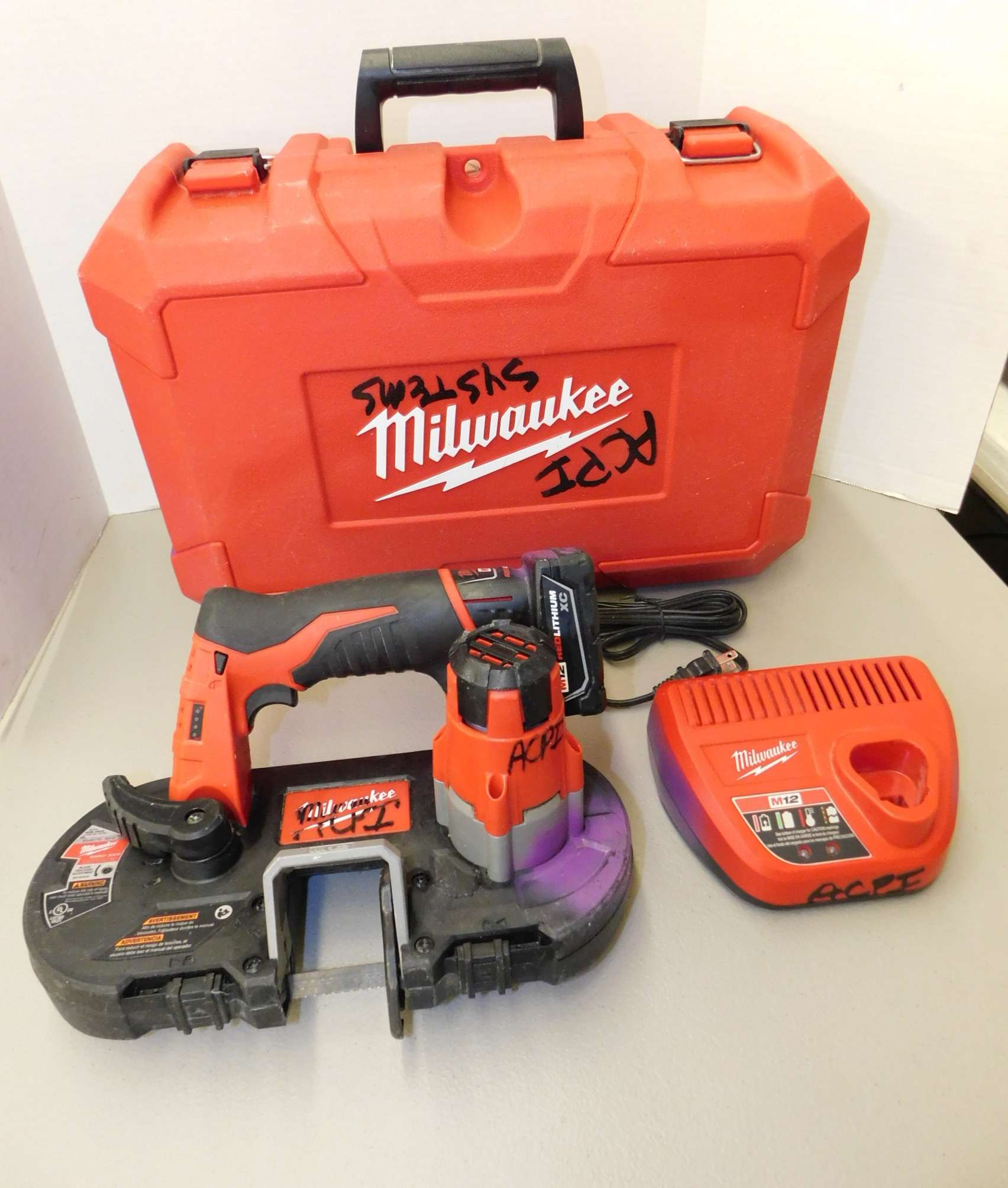 Lot 263 - Milwaukee Model 2429-20 12V Cordless Portable Bandsaw with Battery and Charger