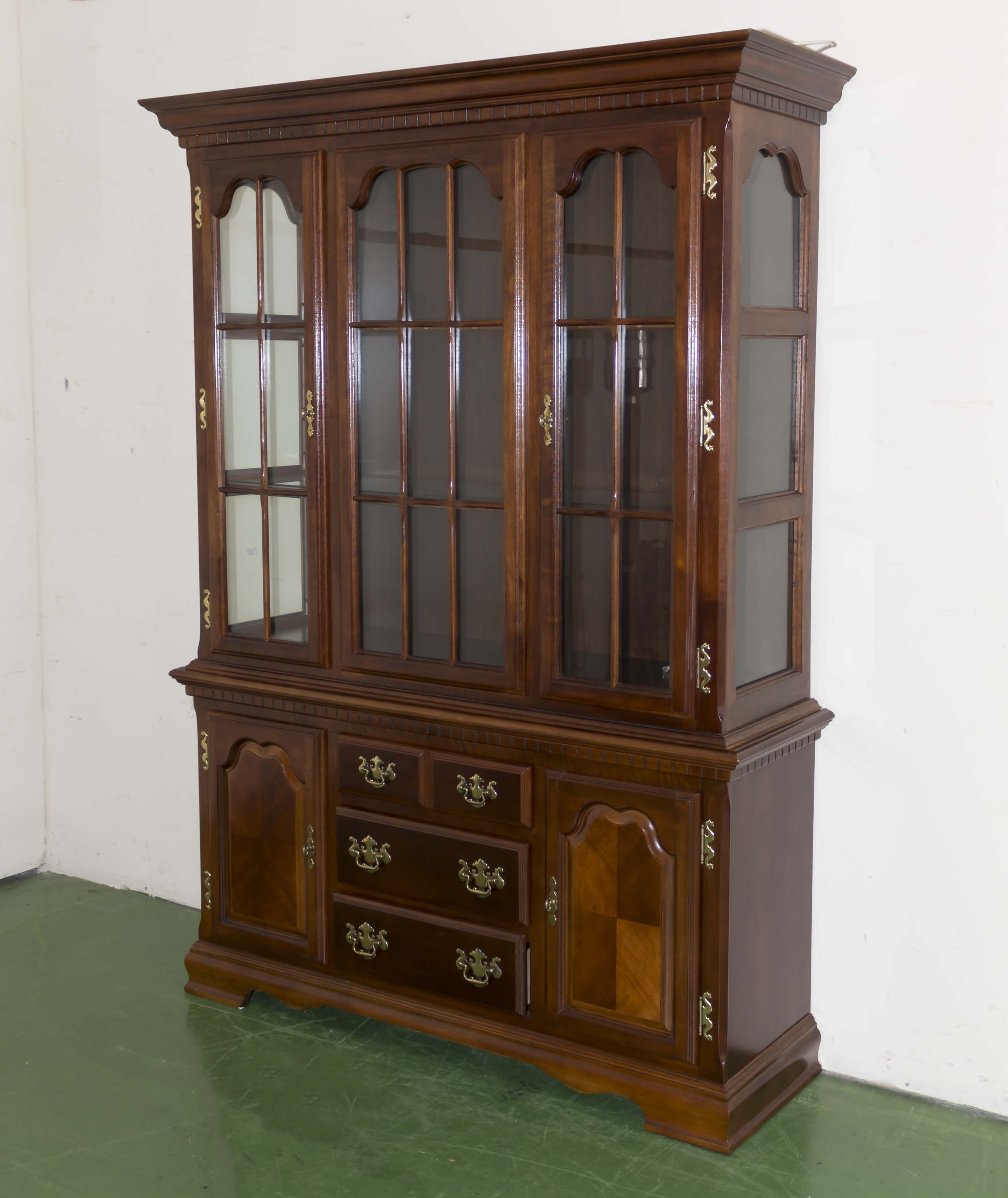 Lot 51 - A reproduction bookcase on cupboards