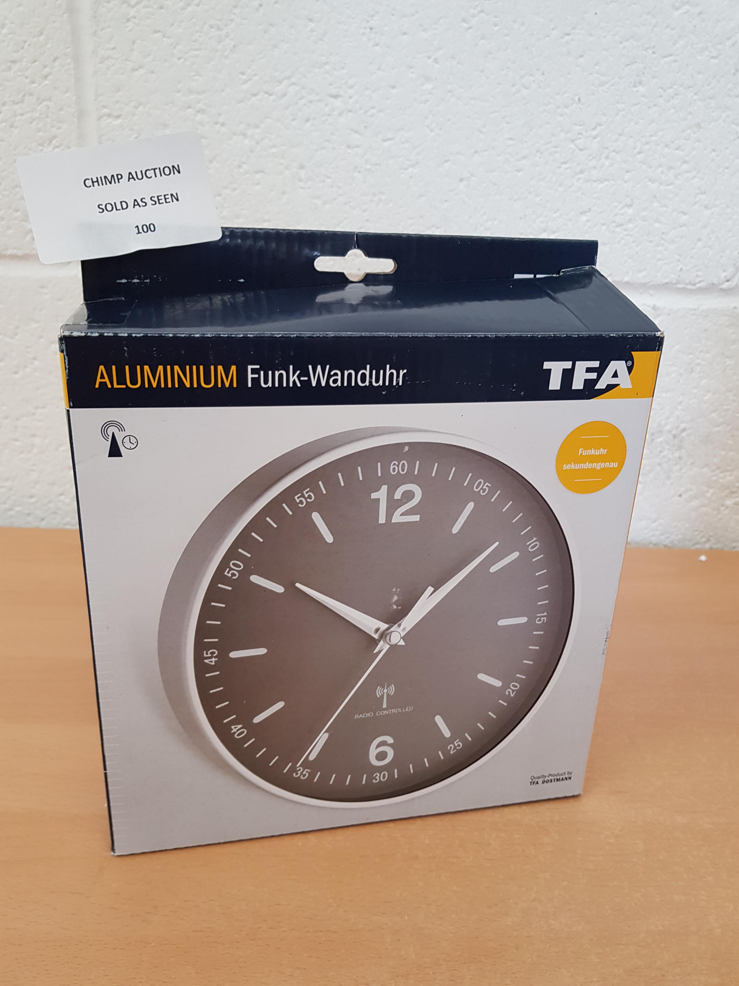 Lot 100 - TFA Aluminium Radio Clock