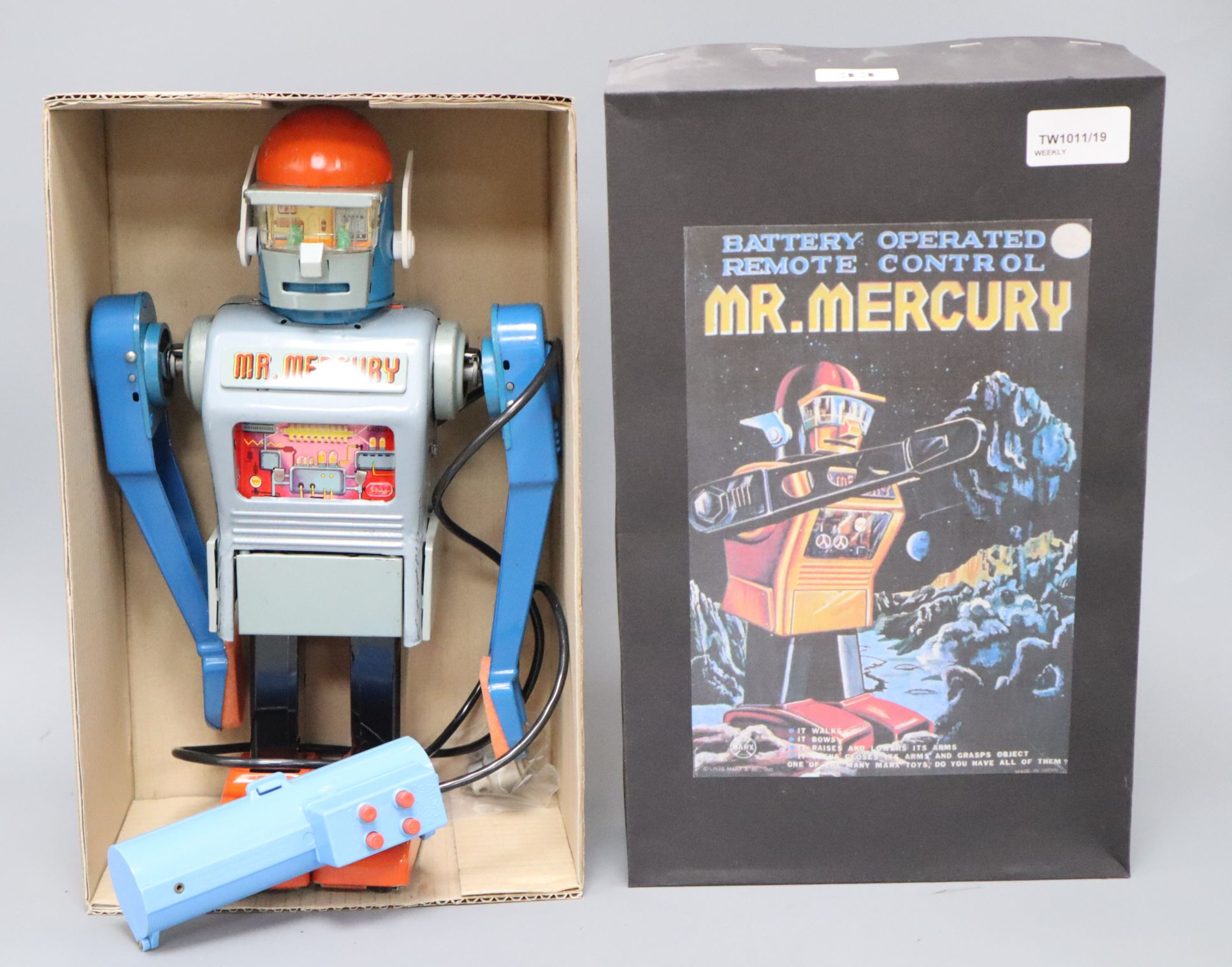 Lot 33 - A Japanese Marx Toys Mr Mercury battery-operated robot, with grey tinplate body, blue arms and head,