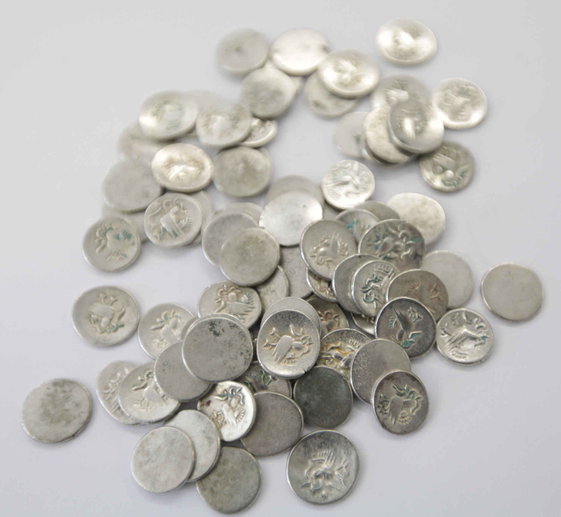 Lot 697 - CAMBODIAN SILVER COINAGE. (80) C 1840 Tical coinage in silver, of one side strikings.