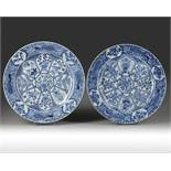 A PAIR OF LARGE CHINESE BLUE AND WHITE PEACOCK CHARGERS, KANGXI PERIOD (1662-1722)