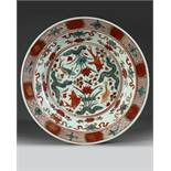 A CHINESE WANLI POLYCHROME-DECORATED 'CARPS' DISH, 16TH CENTURY