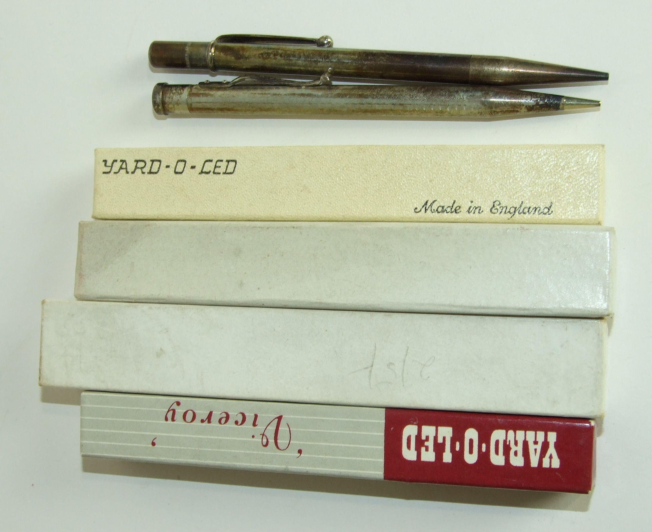 Lot 326 - Four boxed and two other silver pencils, Yard-O-Led and others, (6).