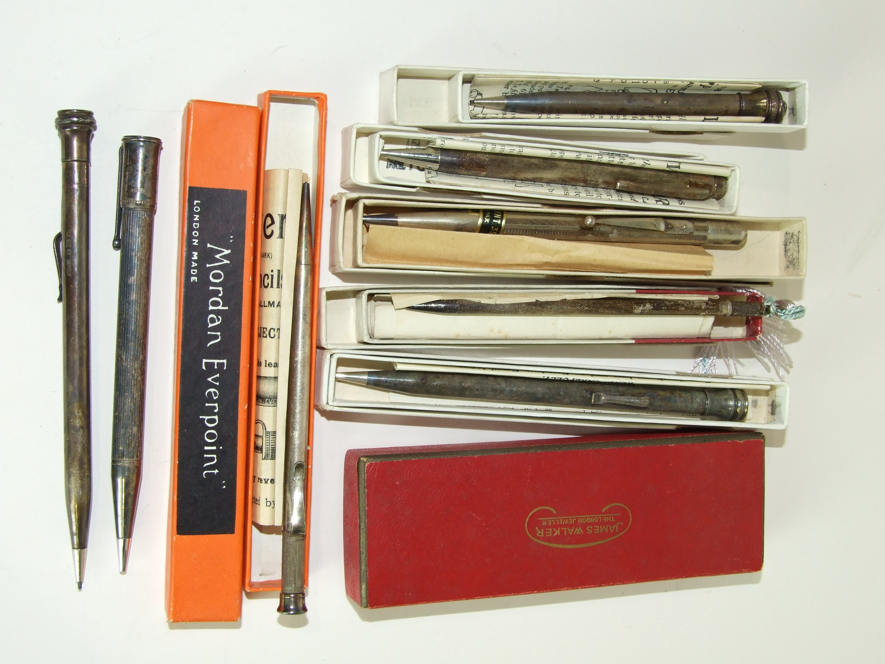 "Lot 323 - A Sampson Mordan & Co ""Everpoint"" silver pencil, boxed, and eight other silver pencils including"