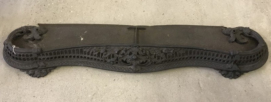 Lot 1035 - A large decorative wrought iron fire fender.