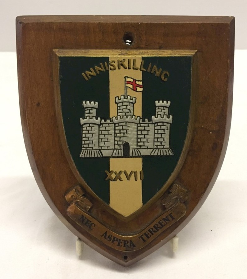 Lot 1043 - Painted Inniskillings badge on wooden shield 18cm x 15cm.