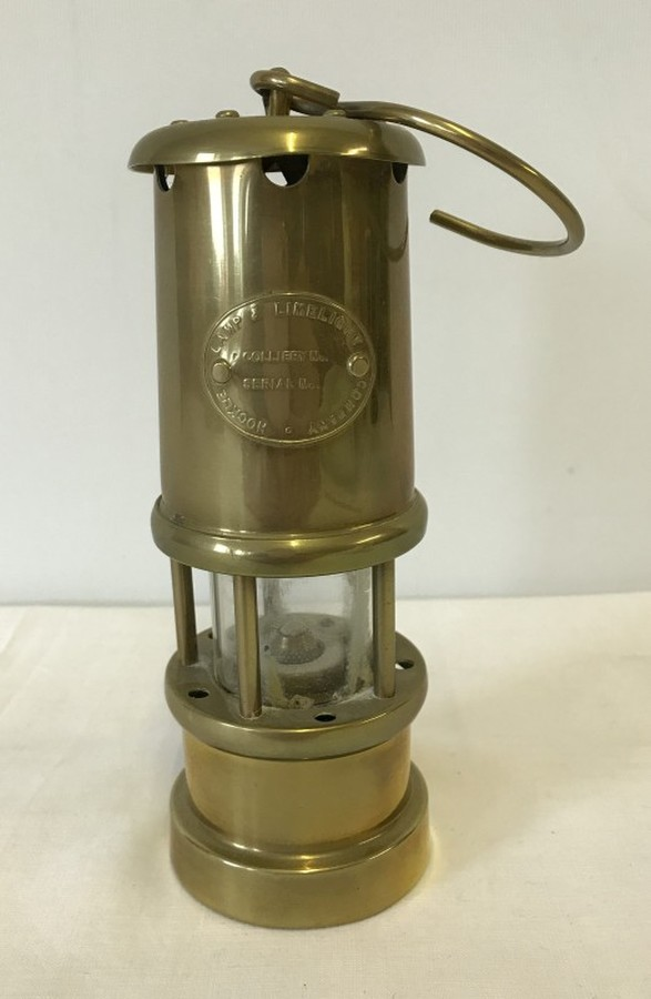 Lot 1036 - A small brass miner lamp by Lamp and Limelight company of Hockley.