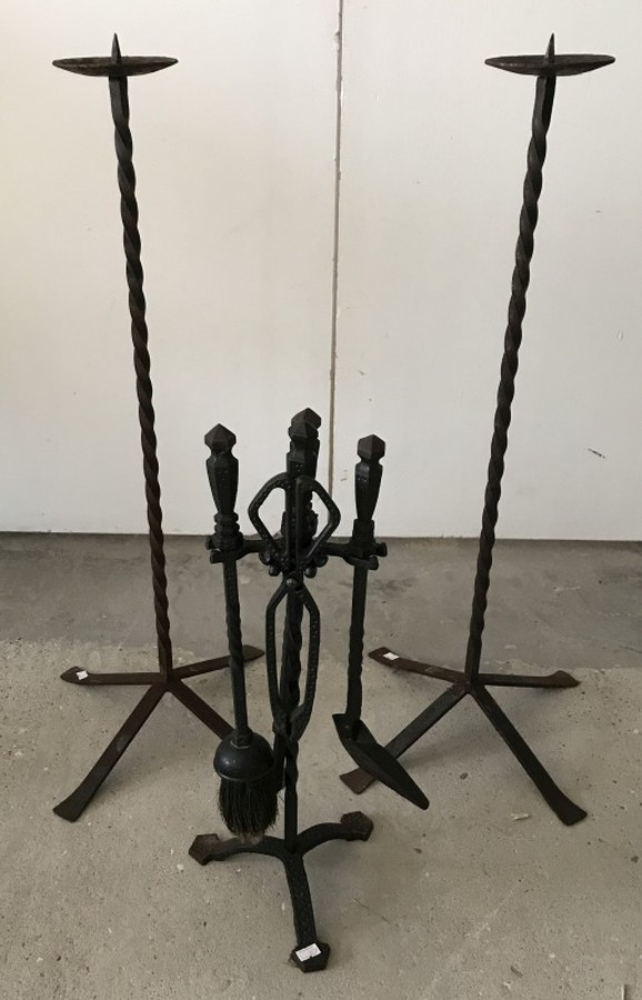 Lot 1034 - Cast iron fireside companion together with a pair of cast iron candle stands.