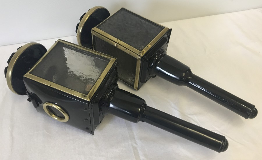Lot 1013 - A pair of vintage carriage lamps with makers mark inside.