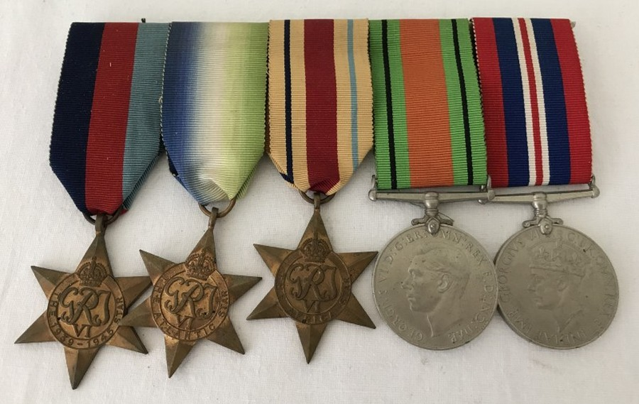 Lot 1053 - A WWII 5 medal group re Walter Brian Redditt serving in the Royal Navy.