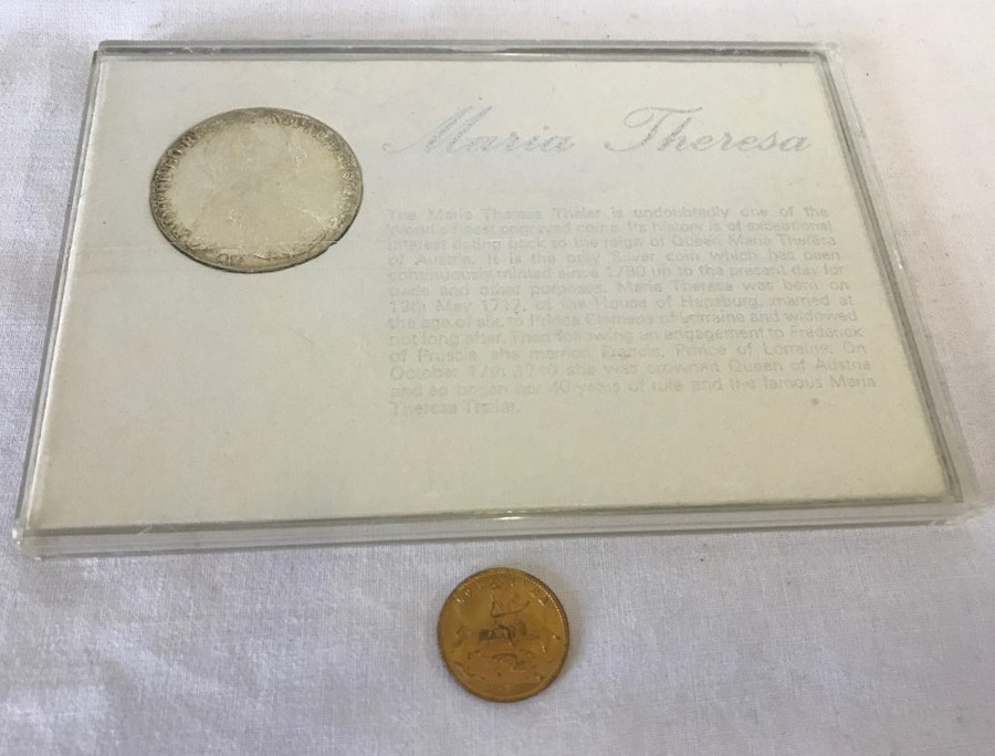 Lot 1008 - A 1780 Maria Theresa silver Thaler in presentation case, with a 1837 brass 'To Hanover' token.