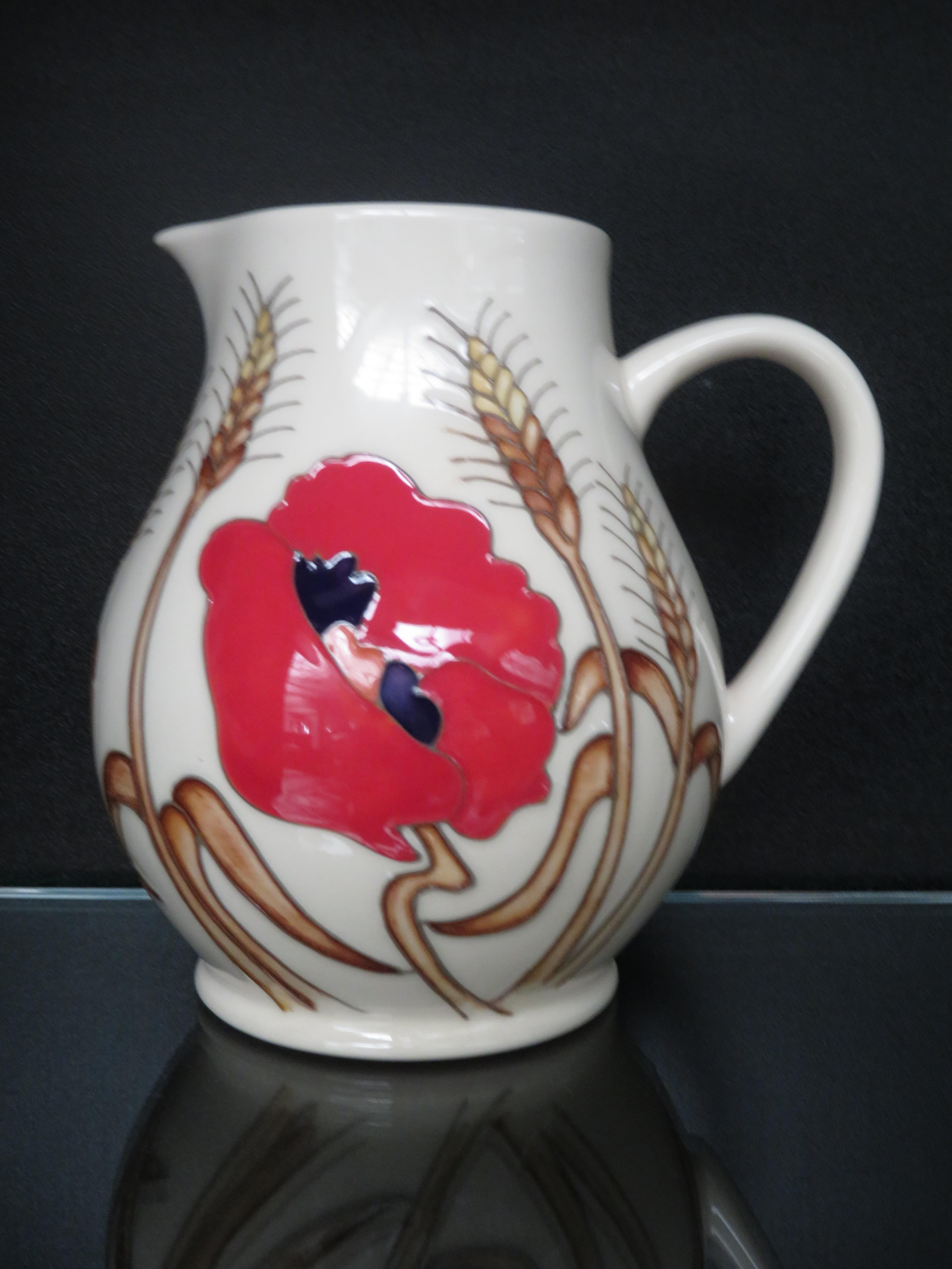Lot 81 - Moorcroft harvest poppy vase Height 15 cm