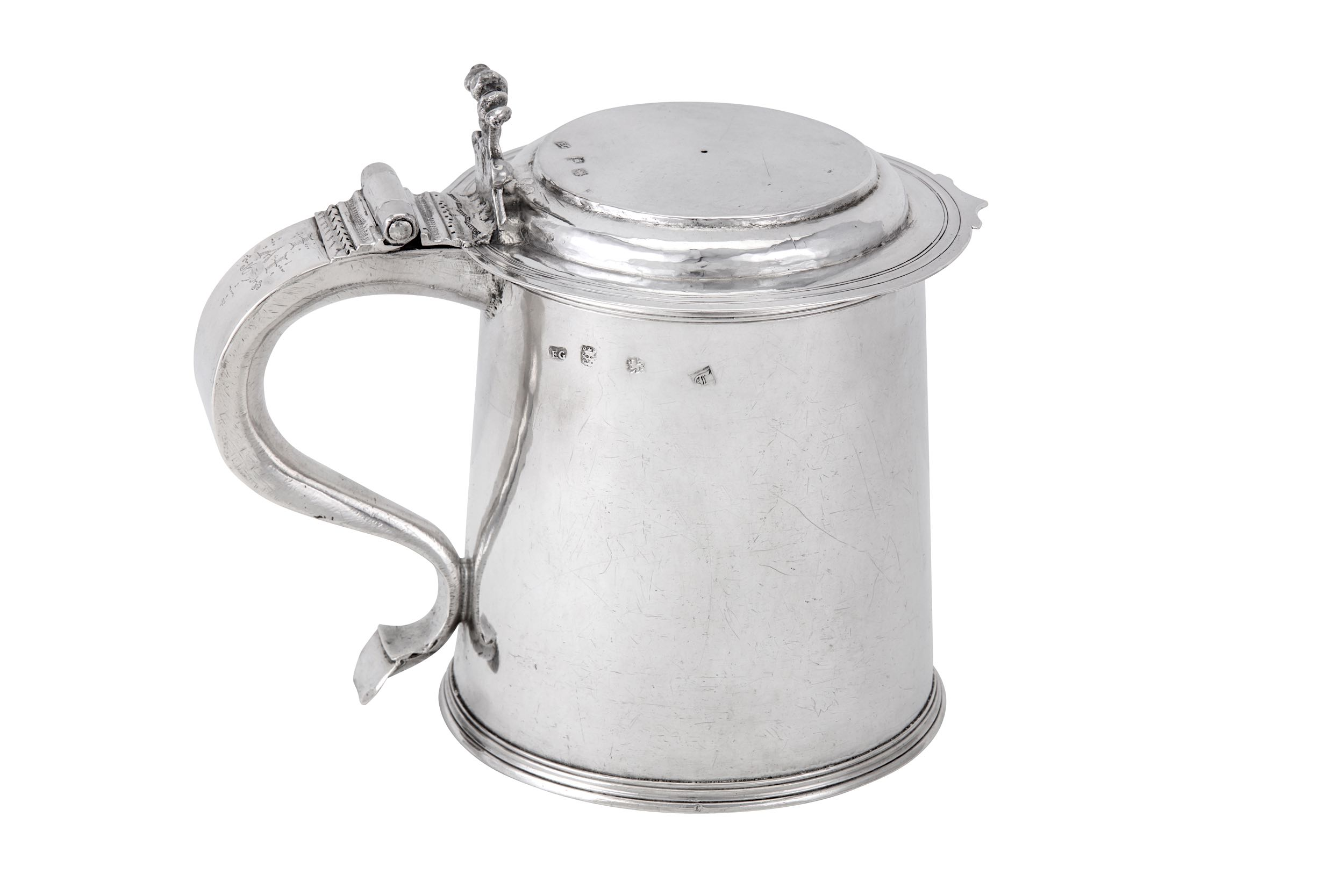 Lot 234 - A Charles II sterling silver tankard, London 1676 by E G in a rectangle, attributed to Edward Gladwi