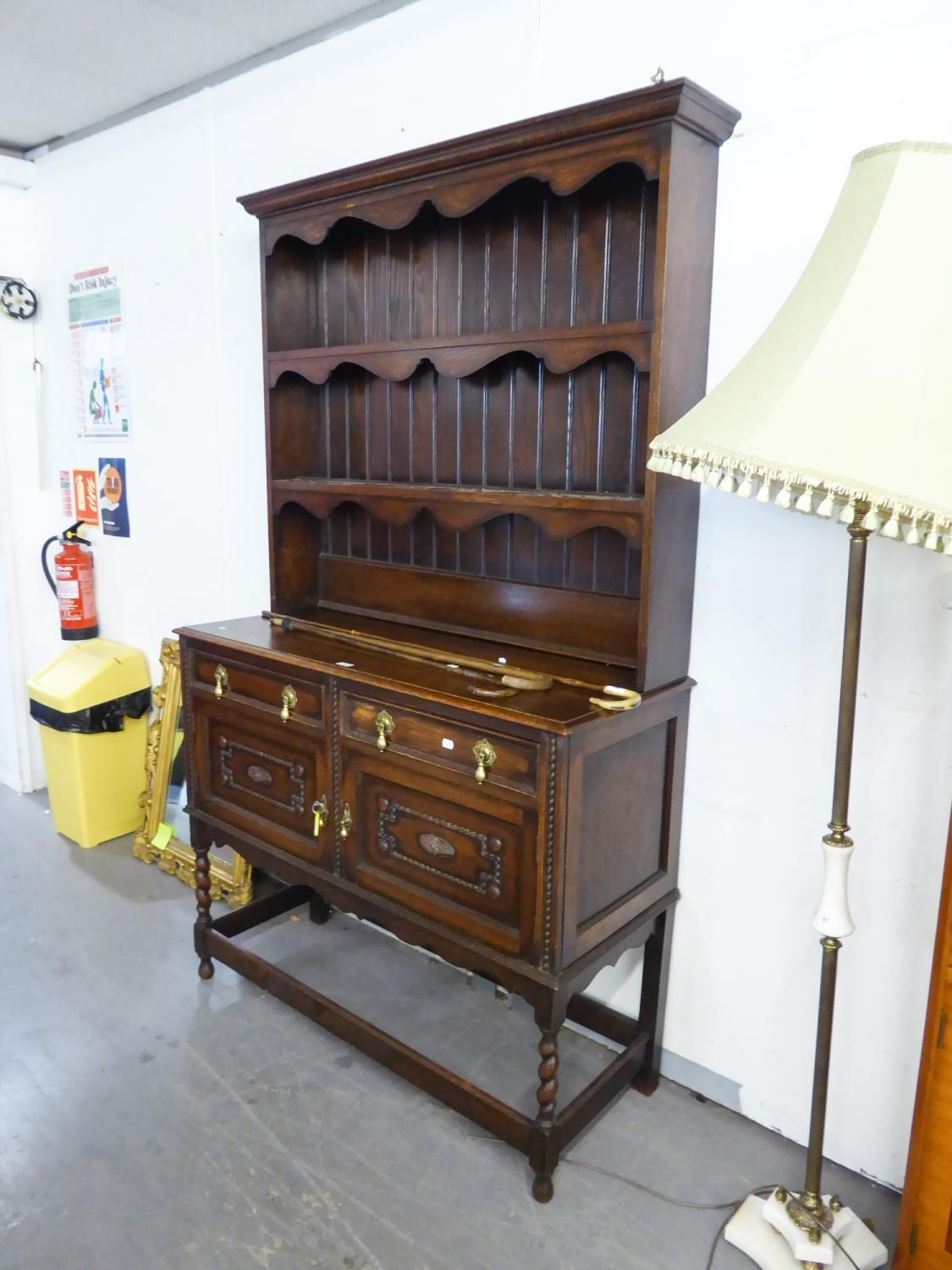 Lot 38 - AN EARLY TWENTIETH CENTURY OAK DRESSER, having two cupboard doors and 2 drawers tongue and groove