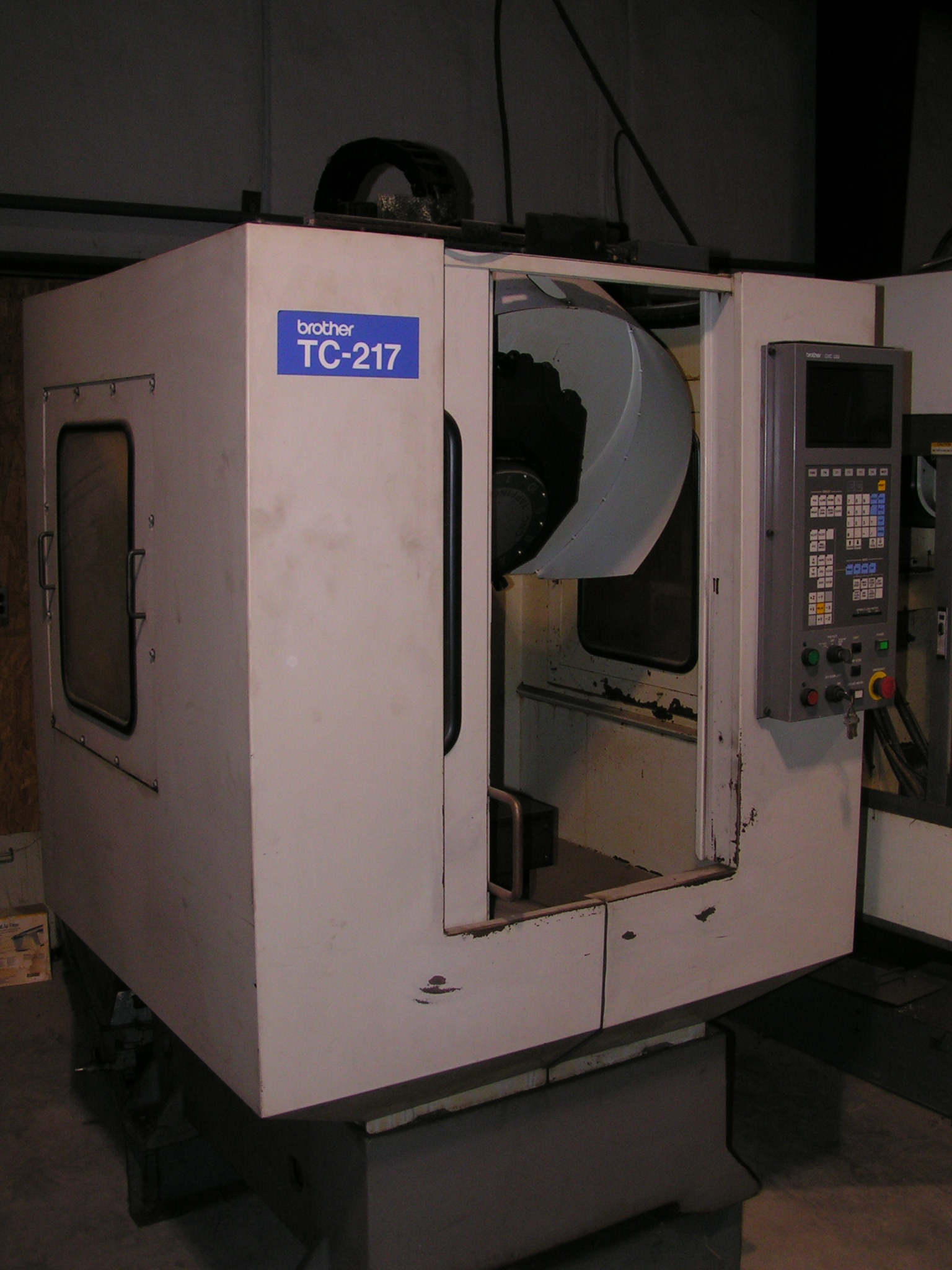 "Lot 26 - CNC DRILLING & TAPPING CENTER, BROTHER MDL. TC-217, new 1991, Brother 520 CNC control, 11.8"" X-"
