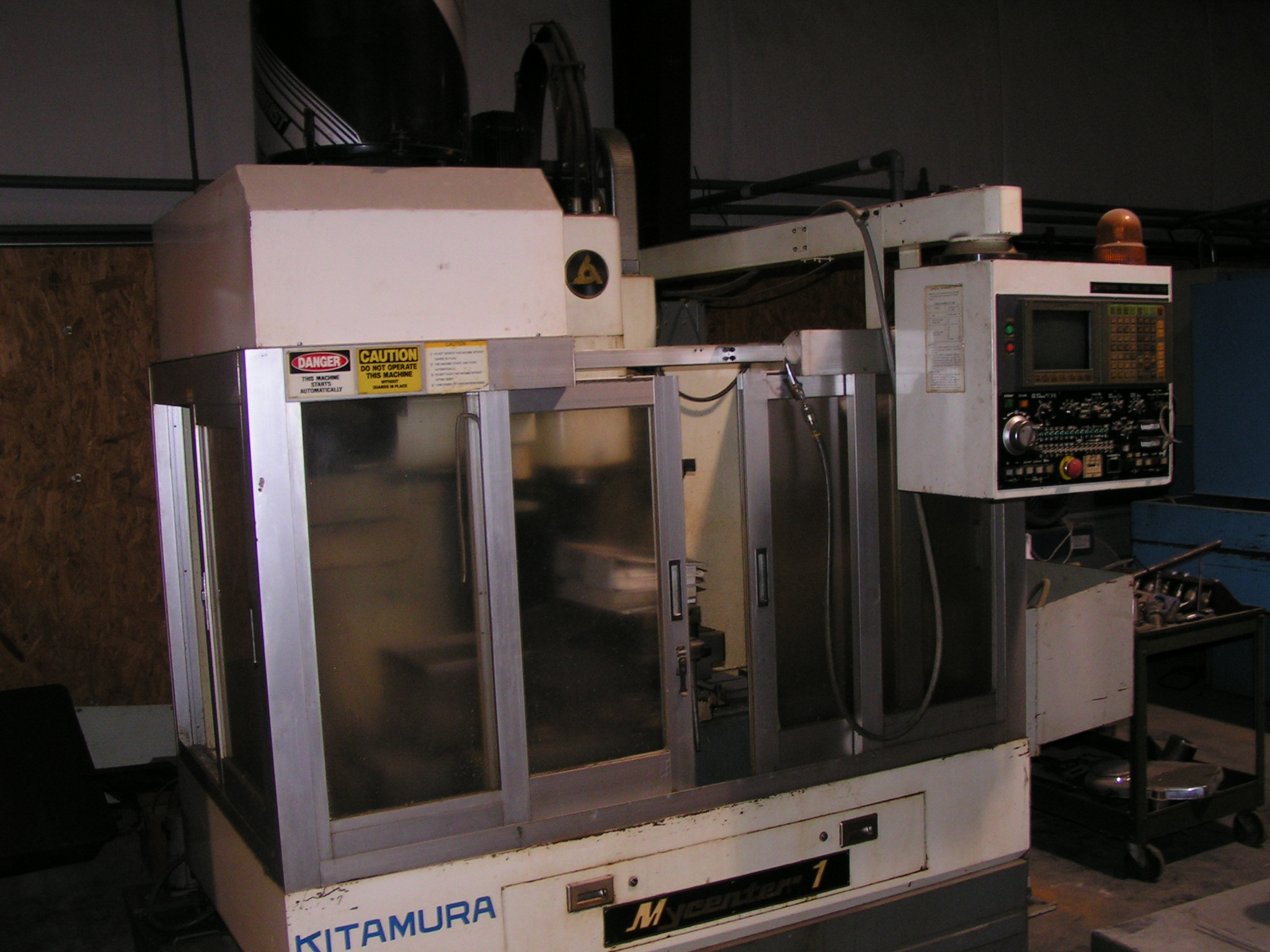 "Lot 28 - CNC DRILLING CENTER, KITAMURA MDL. MYCENTER 1, Yasnac I80M CNC control, 14"" x 31"" table,"