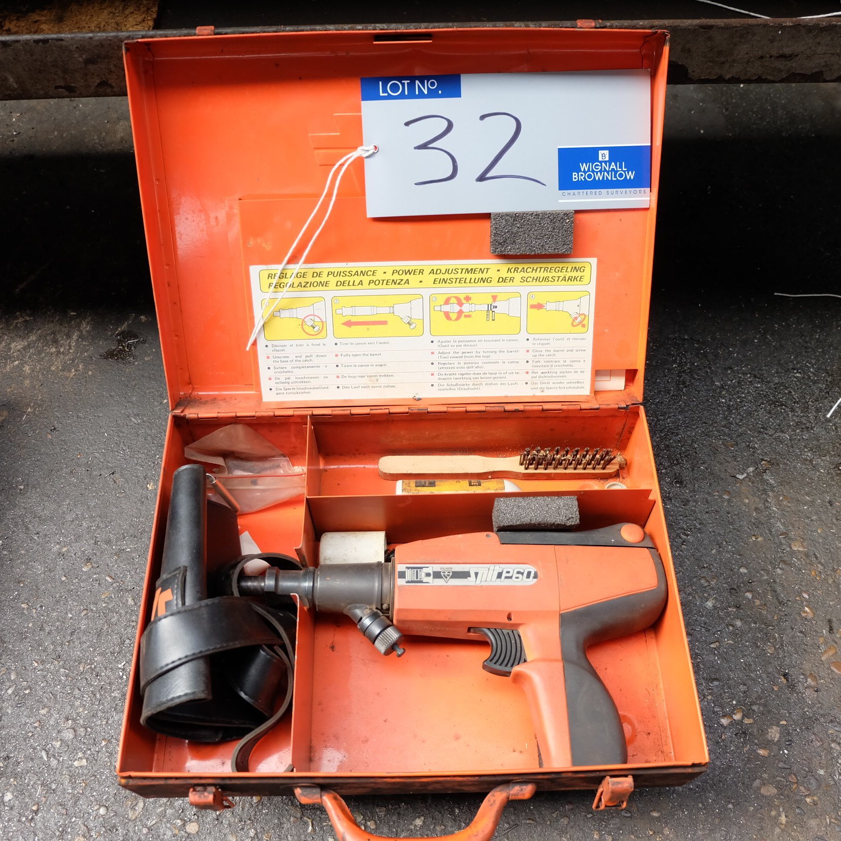 Lot 32 - A Spit P60 Pneumatic Nailing Gun and case.